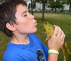Boy at Camp with Frog