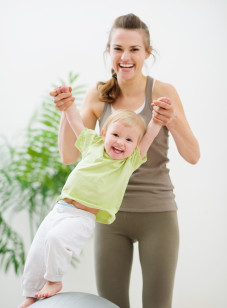 Mother and baby having fun in gym