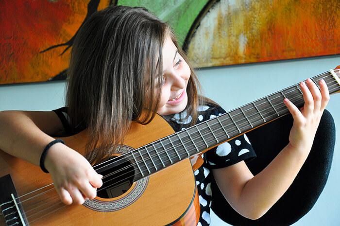 girl-playing-guitar-88keys