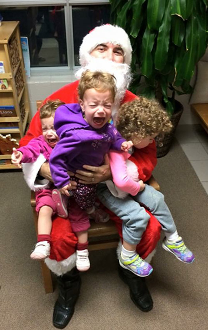 Crying kids with Santa