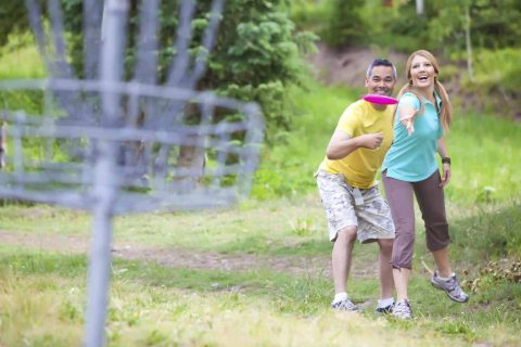 Couple playing Disc Golf